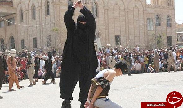 جلاد بولدوزر داعشی در حال گردن زدن + عکس